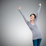 Menina bonita que gesticula os punhos triunfais Foto de Stock Royalty Free
