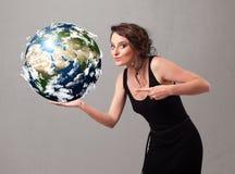 Menina bonita que guardara a terra do planeta 3d Fotografia de Stock Royalty Free