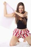 Menina bonita que joga e que graceja com um descanso Foto de Stock Royalty Free