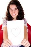Menina bonita que mostra lhe o coração Fotos de Stock Royalty Free