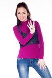 Menina bonita que mostra quatro dedos Imagem de Stock Royalty Free