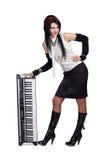 Menina bonita que permanece com o sintetizador isolado Imagens de Stock Royalty Free