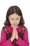 Menina bonita que praying com olhos fechados Fotografia de Stock Royalty Free