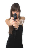 Menina bonita que prende um revólver Foto de Stock Royalty Free