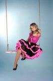 Menina bonita que senta-se no balanço Imagem de Stock Royalty Free