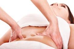 Menina bonita que tem a massagem do estômago. fotografia de stock