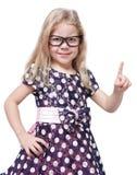 Menina bonita restrita nos vidros que mostram o dedo isolado imagens de stock royalty free