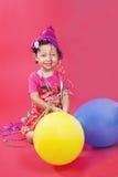 Menina bonito com balões imagens de stock