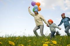 Menina bonito com balões fotografia de stock royalty free