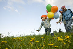 Menina bonito com balões Foto de Stock Royalty Free