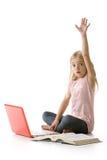 Menina bonito com o portátil, levantando sua mão foto de stock royalty free