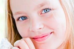 Menina bonito com olhos azuis grandes Imagem de Stock Royalty Free