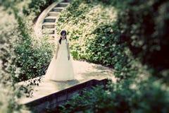 Menina bonito com seu primeiro vestido do comunhão imagens de stock royalty free