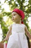 Menina bonito com um olhar inocente Imagens de Stock Royalty Free