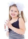 Menina bonito com um vidro do leite Fotografia de Stock Royalty Free