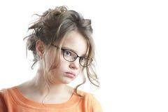 Menina bonito com uma expressão triste em sua cara Fotografia de Stock Royalty Free