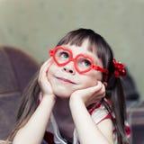 Menina bonito com vidros na forma da Imagens de Stock Royalty Free