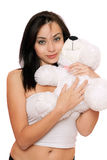 Menina bonito de sorriso com um teddybear Imagens de Stock