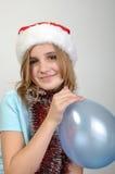 Menina bonito do xmas com um balão Fotografia de Stock