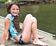 Menina bonito em uma doca Imagens de Stock Royalty Free