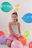 Menina bonito engraçada com baloons Fotografia de Stock