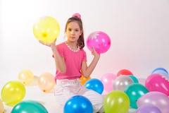 Menina bonito engraçada com baloons Imagem de Stock