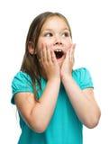 A menina bonito está guardando sua cara na admiração Imagens de Stock