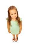Menina bonito na camisa verde em um fundo branco Fotos de Stock
