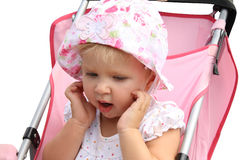 Menina bonito no carro de bebê Imagens de Stock Royalty Free