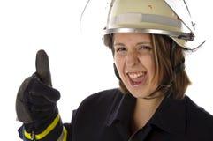 Menina bonito no uniforme do sapador-bombeiro Fotografia de Stock