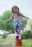 Menina bonito pequena no campo de jogos Fotos de Stock Royalty Free