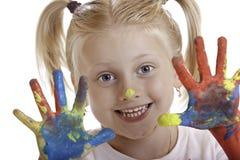 A menina bonito pintou as mãos Fotos de Stock Royalty Free