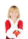 Menina bonito que aprecia o Natal Fotos de Stock Royalty Free