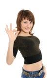 Menina bonito que dá o sinal APROVADO Foto de Stock Royalty Free