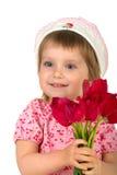 Menina bonito que dá tulips cor-de-rosa Imagens de Stock Royalty Free