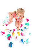 Menina bonito que faz cópias coloridas da mão Imagem de Stock Royalty Free