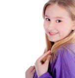 Menina bonito que sorri sobre o branco fotografia de stock