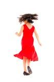 Menina bonito que toma uma volta da ação, isolada no branco Foto de Stock Royalty Free
