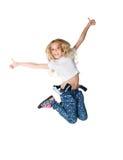 A menina bonito salta Foto de Stock