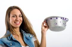 Menina brincalhão com um chapéu de prata do palhaço imagens de stock royalty free