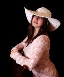 Menina, chapéu e cadeira Imagem de Stock Royalty Free
