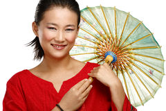 Menina chinesa bonita com o guarda-chuva caseiro tradicional foto de stock