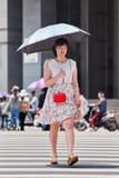 Menina chinesa com o guarda-chuva como o construtor do sol, Kunming, China Imagem de Stock Royalty Free