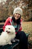 Menina chinesa com um cão Foto de Stock Royalty Free