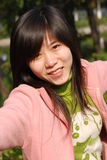 Menina chinesa de sorriso Imagens de Stock Royalty Free