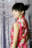 Menina chinesa nas cenas da neve Foto de Stock Royalty Free