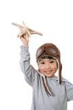 Menina chinesa pequena asiática que joga com Toy Airplane Imagens de Stock