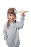 Menina chinesa pequena asiática que joga com Toy Airplane Fotos de Stock