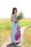 A menina coleta flores Imagem de Stock Royalty Free