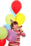 Menina com aniversário da trombeta e dos balões Fotografia de Stock Royalty Free